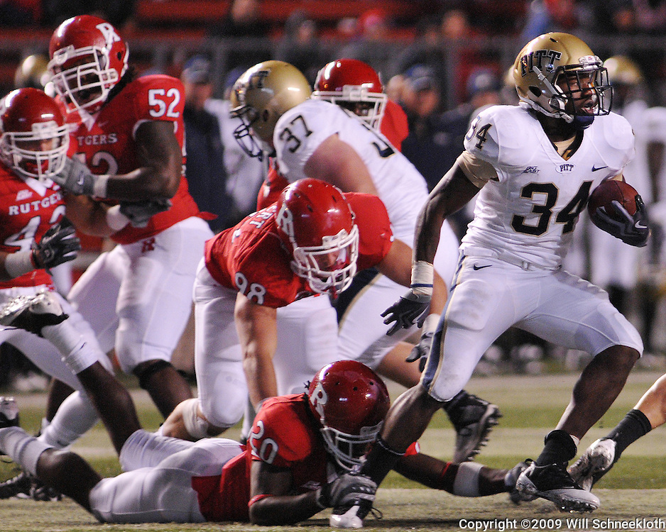 Oct 16, 2009; Piscataway, NJ, USA; Pittsburgh running back Ray Graham (34) spins away from Rutgers defenders during second half NCAA football action in Pittsburgh's 24-17 victory over Rutgers at Rutgers Stadium.
