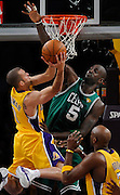 Jordan Farmar goes strong to the hoop against Kevin Garnett in the first half. The Lakers defeated the Boston Celtics in game 6 of the NBA Finals 89-67. Los Angeles, CA 06/15/2010 (John McCoy/Staff Photographer).