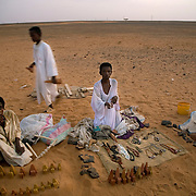 Sudanese boys try to sell souvenirs to the only tourists at the Meroe pyramids (the journalist and photographer) before the sun sets.This is one of many  archeaological sites that Sudanese hope will attract tourists. Tourism is lagging in Sudan because of Western perceptions that it is an unstable country.