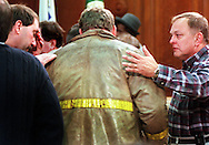 TGLOCAL Emotionally wrought firefighter representitive Frank Raffa(L) and City Mgr. Tom Hoover (R) comfort distraught Fire Chief Dennis Budd after a press conference in City Council chambers Saturday Morning. Shoot date 12/4/99
