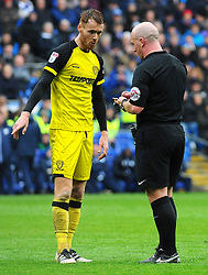 Referee Simon Hooper gives a yellow card to Tom Naylor of Burton Albion  - Mandatory by-line: Nizaam Jones/JMP- 30/03/2018 -  FOOTBALL -  Cardiff City Stadium- Cardiff, Wales -  Cardiff City v Burton Albion - Sky Bet Championship