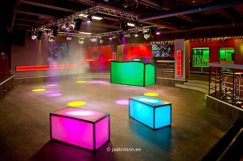Nightclub Tallinn bar interior in Tartu, Estonia. Coloured lights, decor and decorative lit features. Lighting scheme. Nightlife. Dance floor.