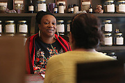 BROOKLYN, NY, APRIL 2, 2016:  Karen Rose, owner and head herbalist at Sacred Vibes apothecary in Ditmas Park, with her consult, a highschool teacher from Corona, Queens.  Rose has had consults come from as far as Maryland. 04/02/2016 (Kazi Awal/NYCity News Service)