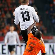 NLD/Amsterdam/20121114 - Vriendschappelijk duel Nederland - Duitsland, Bruno Martins Indi in duel met Thomas Muller