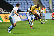 AFC Wimbledon striker Tyrone Barnett (23) controls the ball during the EFL Sky Bet League 1 match between Coventry City and AFC Wimbledon at the Ricoh Arena, Coventry, England on 28 September 2016. Photo by Stuart Butcher.