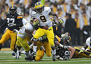 November 05, 2011: Michigan Wolverines returner Martavious Odoms (9) is hit by Iowa Hawkeyes defensive back B.J. Lowery (19) as he runs back a kick during the second half of the NCAA football game between the Michigan Wolverines and the Iowa Hawkeyes at Kinnick Stadium in Iowa City, Iowa on Saturday, November 5, 2011. Iowa defeated Michigan 24-16.