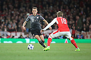 Bayern Munich defender Rafinha (13) dribbling and taking on Arsenal defender Nacho Monreal (18) during the Champions League round of 16, game 2 match between Arsenal and Bayern Munich at the Emirates Stadium, London, England on 7 March 2017. Photo by Matthew Redman.