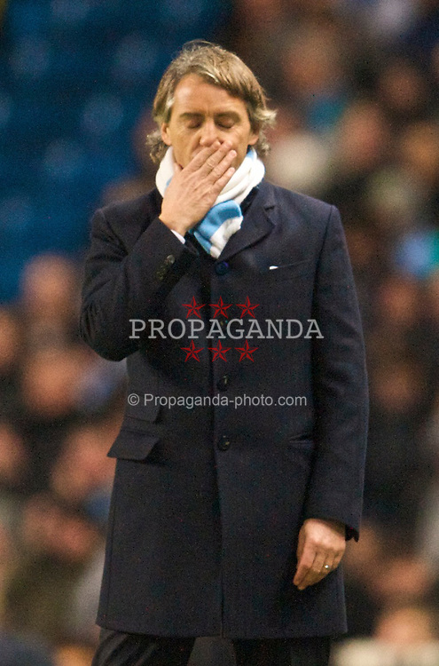 MANCHESTER, ENGLAND - Tuesday, January 19, 2010: Manchester City's manager Roberto Mancini during the Football League Cup Semi-Final 1st Leg match against Manchester United at the City of Manchester Stadium. (Photo by David Rawcliffe/Propaganda)