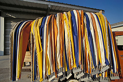 Colorful assortment of beach umbrellas await rental by bathers in Tampa Florida.