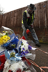 © Licensed to London News Pictures. 11/04/2018. London, UK. A man who gave his name as Iain Gordon removes floral tributes from near the house of Richard Osborn-Brooks. Henry Vincent was killed as he burgled the home of 78 year old Richard Osborn-Brooks. Mr Osborn-Brooks was arrested for murder but later released without charge. Friends and family of Henry Vincent have had floral tributes they placed near the scene repeatedly torn down by locals. Photo credit: Peter Macdiarmid/LNP