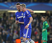 Chelsea's Gary Cahill congratulates Chelsea's Andre Schürrle after scoring Chelsea's second during the UEFA Champions League match between Chelsea and Sporting Lisbon at Stamford Bridge, London, England on 10 December 2014.