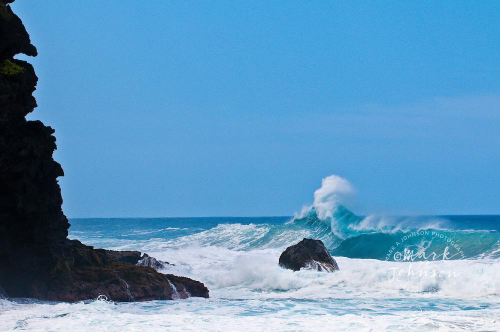 Wave breaking off the Na Pali coast, Kauai, Hawaii