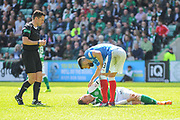 Russell Martin checks on injured Florian Kamberi during the Ladbrokes Scottish Premiership match between Hibernian and Rangers at Easter Road, Edinburgh, Scotland on 13 May 2018. Picture by Kevin Murray.