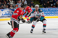 KELOWNA, CANADA - APRIL 19: Madison Bowey #4 of the Kelowna Rockets checks Chase De Leo #9 of the Portland Winterhawks on April 18, 2014 during Game 2 of the third round of WHL Playoffs at Prospera Place in Kelowna, British Columbia, Canada.   (Photo by Marissa Baecker/Shoot the Breeze)  *** Local Caption *** Madison Bowey; Chase De Leo;