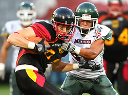 08.07.2011, Tivoli Stadion, Innsbruck, AUT, American Football WM 2011, Group A, Germany (GER) vs Mexico (MEX), im Bild López Rassiel gregorio (Mexico, #28, FS) tries to stop Niklas Römer (Germany, #84, WR)  // during the American Football World Championship 2011 Group A game, Germany vs Mexico, at Tivoli Stadion, Innsbruck, 2011-07-08, EXPA Pictures © 2011, PhotoCredit: EXPA/ T. Haumer