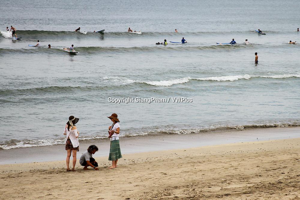 Strolling on Kuta Beach, Bali, Indonesia