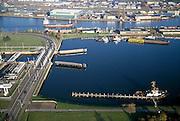 Nederland, Zeeuwsch-Vlaanderen, Terneuzen, 15/11/2001;  haven Terneuzen, met Kanaal Terneuzen-Gent (zie ook detailfoto's); links de zeesluis; coaster in het zijkanaal; binnenvaart kustvaart scheepvaart sleepbooot.<br /> luchtfoto (toeslag), aerial photo (additional fee)<br /> photo/foto Siebe Swart