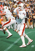 COLLEGE FOOTBALL:  Stanford v Cal in the 87th Big Game played on November 17, 1984 at Memorial Stadium in Berkeley, California.  John Paye #14 attempts a pass; John Barns #74 blocks.  Photograph by David Madison (www.davidmadison.com).