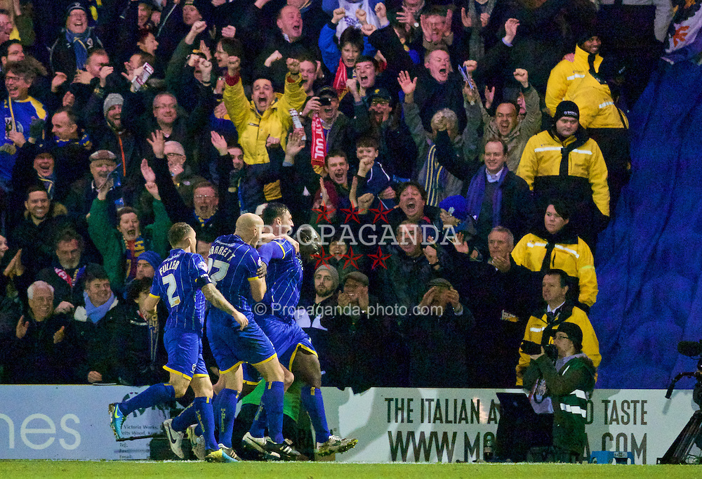 KINGSTON-UPON-THAMES, ENGLAND - Monday, January 5, 2015: AFC Wimbledon's Adebayo Akinfenwa celebrates scoring the first goal against Liverpool during the FA Cup 3rd Round match at the Kingsmeadow Stadium. (Pic by David Rawcliffe/Propaganda)