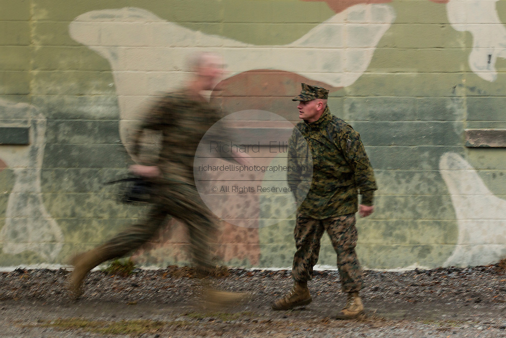 A US Marine runs at the command of a drill instructor during bootcamp January 13, 2014 in Parris Island, SC.