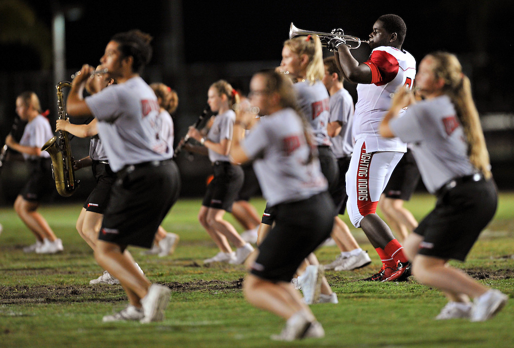 Xavier Mascareñas/Treasure Coast Newspapers; Vero Beach tackle Durosier Thompson performs during halftime with the Vero Beach High School Marching Band during their football game against Martin County High School in Stuart on Friday, Sept. 5, 2014. Vero Beach beat Martin County 42-0.