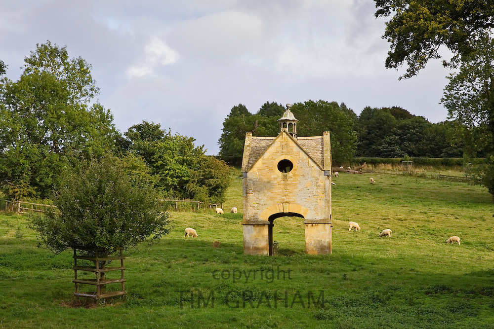 Folly of two-storey dovecote with open ground floor, Chastleton House, Oxfordshire, UK