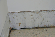 Home care. a room is being re plastered and is ready for painting. The plaster was redone due to dampness in the wall that allowed the growth of mould