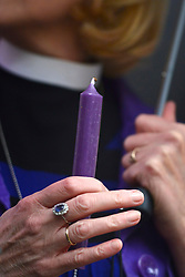 © Licensed to London News Pictures. 21/11/2012. westminster, UK A women holds a candle at vigil at Church House in Westminster today 21 November 2012, Candles were not lit and will not be lit until women are ordained as priests. London for day three of the three-day Church of England General Synod. Members last night voted against ordaining women as priests.. Photo credit : Stephen Simpson/LNP