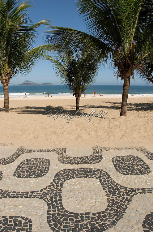 Ipanema beach with signature sidewalk tile design and palm trees..RIO DE JANERIO, BRAZIL.Not model released.
