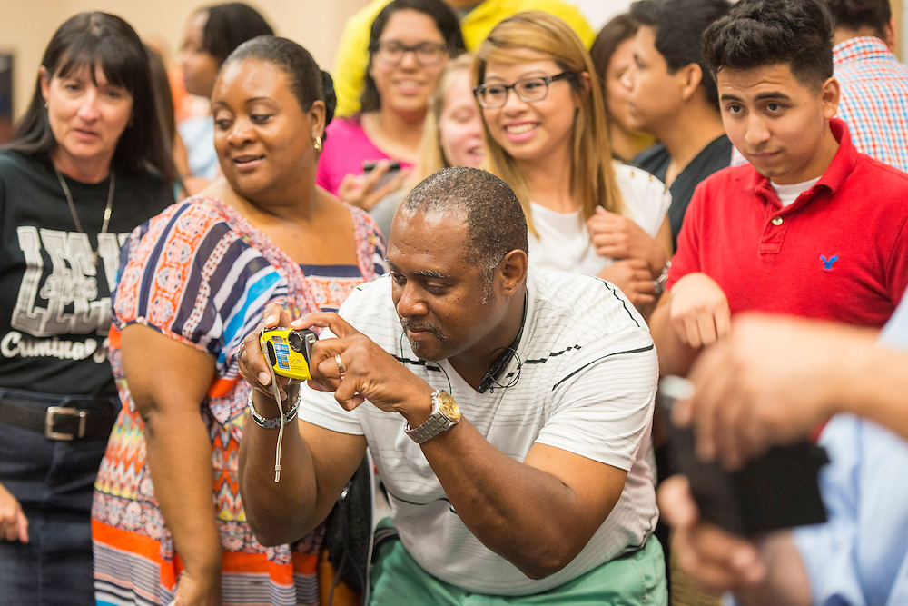 Family and friends crowd around students during the Academic Signing Day activities at the Region 4 Education Center, May 23, 2014.