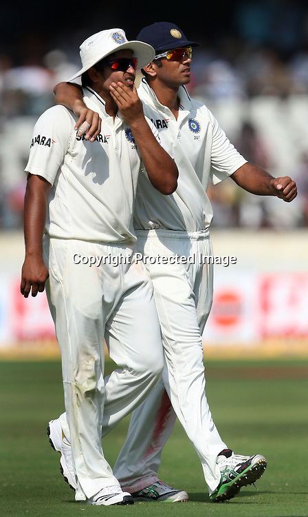 Indian players Suresh Raina and Rahul Dravid during the Indian vs New Zealand 2nd test match day-5 Played at Rajiv Gandhi International Stadium, Uppal, Hyderabad 16 November 2010 (5-day match)