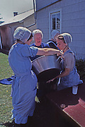 "Conservative ""horse and buggy"" Mennonite women prepare group meal, New Holland, Lancaster Co., PA"
