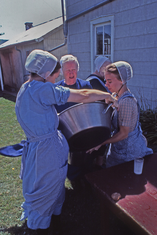"""Conservative """"horse and buggy"""" Mennonite women prepare group meal, New Holland, Lancaster Co., PA"""