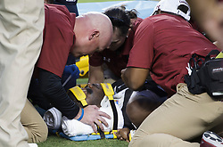 South Carolina wide receiver Terry Googer (6) is looked over by medical personal after being injured during the first quarter of an NCAA college football game against Texas A&M Saturday, Sept. 30, 2017, in College Station, Texas. (AP Photo/Sam Craft)