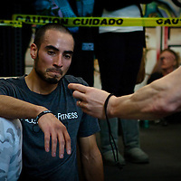 Raph Sandoval confirms his time at the Winter WOD Fest CrossFit competition. Crossfit image, picture, photo, photography of health, elite, exercise, training, workouts, WODs, taken at Progressive Fitness CrossFit,Colorado Springs, Colorado, USA