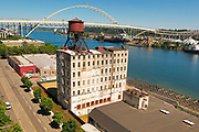 Aerial view of Centennial Mills riverfront redevelopment site on the Willamette River in downtown Portland Oregon. Drone based photograph dated July 18, 2017.