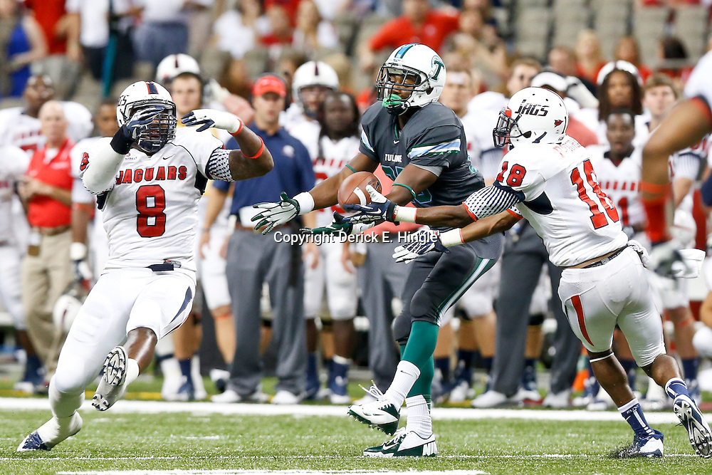 Sep 7, 2013; New Orleans, LA, USA; South Alabama Jaguars safety Terrell Brigham (18) and linebacker Pat Moore (8)  break up a pass to Tulane Green Wave running back Josh Rounds (25) during the second half of a game at the Mercedes-Benz Superdome. South Alabama defeated Tulane 41-39. Mandatory Credit: Derick E. Hingle-USA TODAY Sports