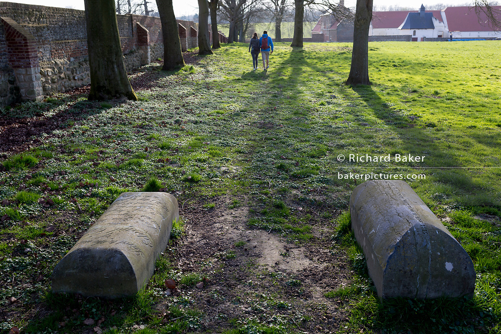 The tombstones of Sergeant-Major Edward Cotton of the 7th Hussars and Captain John Lucie Blackman, an officer of the Coldstream Guards, inside the walls of Hougoumont Farm on the Waterloo battlefield, on 25th March 2017, at Waterloo, Belgium. The farm became an epicentre of fighting in the Battle as it was one of the first places where British and other allied forces faced Napoleon's Army. 12,000 allied troops defending 14,000 French. The Battle of Waterloo was fought on 18 June 1815. A French army under Napoleon Bonaparte was defeated by two of the armies of the Seventh Coalition: an Anglo-led Allied army under the command of the Duke of Wellington, and a Prussian army under the command of Gebhard Leberecht von Blücher, resulting in 41,000 casualties.