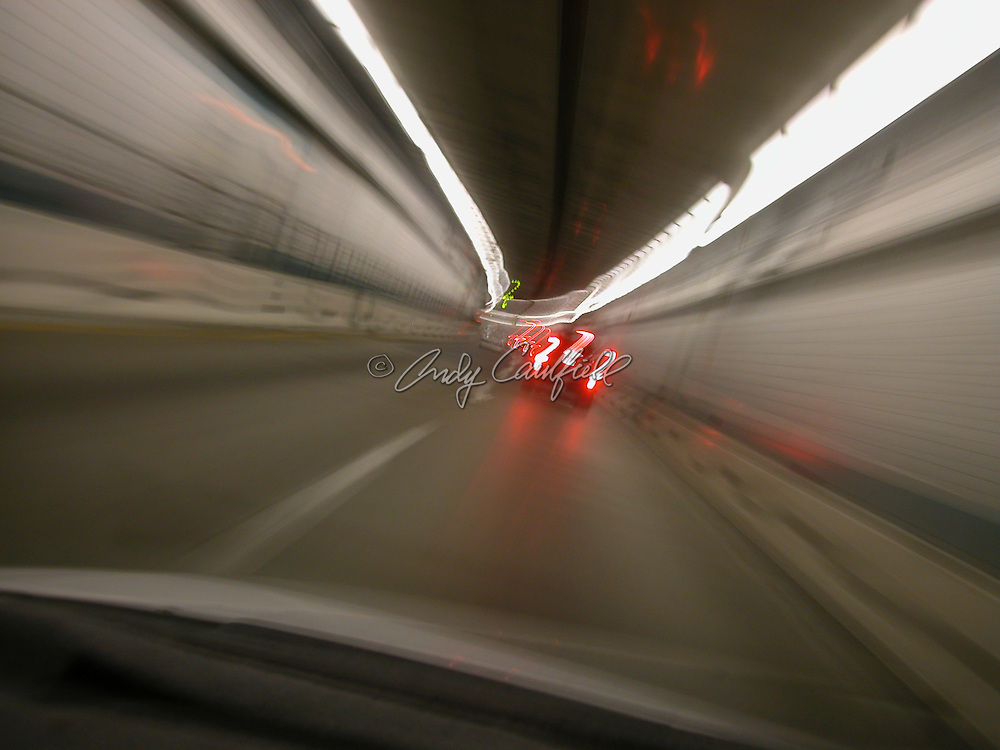 Ted Williams tunnel POV from moving car, Boston, MA.