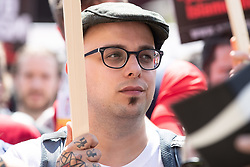 © Licensed to London News Pictures . 19/05/2018. Manchester, UK. DAN HETT (brother of Martin Hett , killed at the Manchester Arena bombing) with Stand Up to Racism campaigners counter-protesting the FLA demo . The Football Lads Alliance demonstrate in Manchester , three days before the first anniversary of the Manchester Arena terror attack . Photo credit: Joel Goodman/LNP