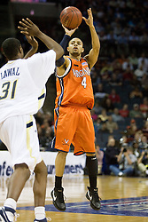Virginia guard Calvin Baker (4) shoots a jump shot over Georgia Tech forward Gani Lawal (31).  The Virginia Cavaliers fell to the Georgia Tech Yellow Jackets 94-76  in the first round of the 2008 ACC Men's Basketball Tournament at the Charlotte Bobcats Arena in Charlotte, NC on March 13, 2008.