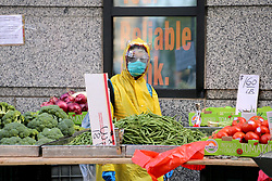 People with face mask in Chinatown during the Covid-19 pandemic in New York City, NY, USA on April 22, 2020. The Big Apple neared a painful milestone Wednesday as the death toll from the coronavirus outbreak that has ravaged the five boroughs approached 15,000. The pandemic has claimed the lives of 14,996 New Yorkers, with new 569 fatalities reported in the most recent 24-hour period, according to data from the city's Department of Health. Photo by Charles Guerin/ABACAPRESS.COM