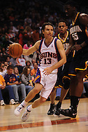 Mar. 6 2010; Phoenix, AZ, USA;  Phoenix Suns guard Steve Nash (13) drives the ball against Indiana Pacers center Roy Hibbert (55) in the second half at the US Airways Center. The Suns defeated the Pacers 113 to 105. Mandatory Credit: Jennifer Stewart-US PRESSWIRE.
