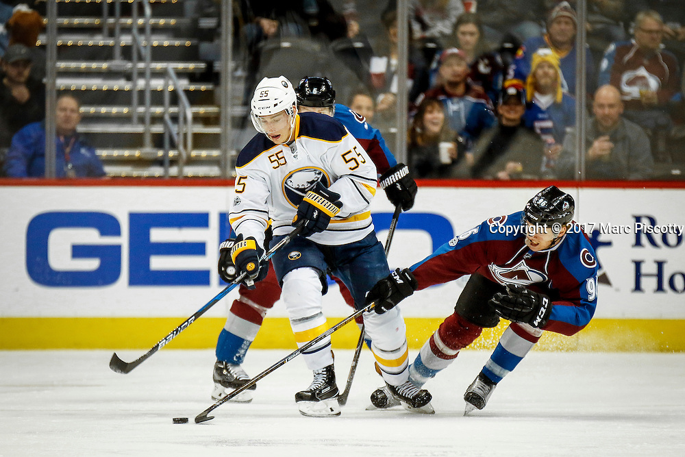 SHOT 2/25/17 9:14:32 PM - The Buffalo Sabres' Rasmus Ristolainen #55 goes after a loose puck in front of the Colorado Avalanche's Mikko Rantanen #96 during their NHL regular season game at the Pepsi Center in Denver, Co. The Avalanche won the game 5-3. (Photo by Marc Piscotty / © 2017)