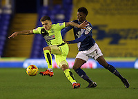 Birmingham City's Demarai Gray (right) and Huddersfield Town's Jamie Paterson battle for the ball.