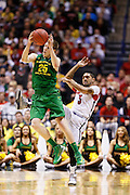 INDIANAPOLIS, IN - MARCH 29: E.J. Singler #25 of the Oregon Ducks steals a pass from Peyton Siva #3 of the Louisville Cardinals during the regional round of the 2013 NCAA Men's Basketball Tournament at Lucas Oil Stadium on March 29, 2013 in Indianapolis, Indiana. (Photo by Joe Robbins)