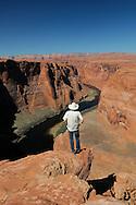 Christian Heeb at Horseshoe Bend, overlooking the Colorado River near Page, Arizona, USA