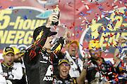 Jeff Gordon wins a NASCAR Sprint Cup series auto race, Saturday, May 10, 2014, at Kansas Speedway in Kansas City, Kan. (AP Photo/Colin E. Braley)