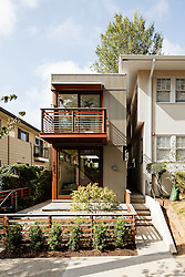 A skinny house, 11ft wide, designed by DAO Architecture LLC of Portland, OR