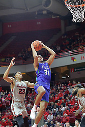 NORMAL, IL - November 06: Dinero Mercurius gets to the hoop past William Tinsley during a college basketball game between the ISU Redbirds  and the Florida Gulf Coast Eagles on November 06 2018 at Redbird Arena in Normal, IL. (Photo by Alan Look)
